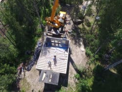This RTM ready-to-move home being craned into position and set on foundation.